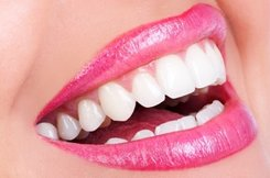 woman smiling wearing pink lip stick